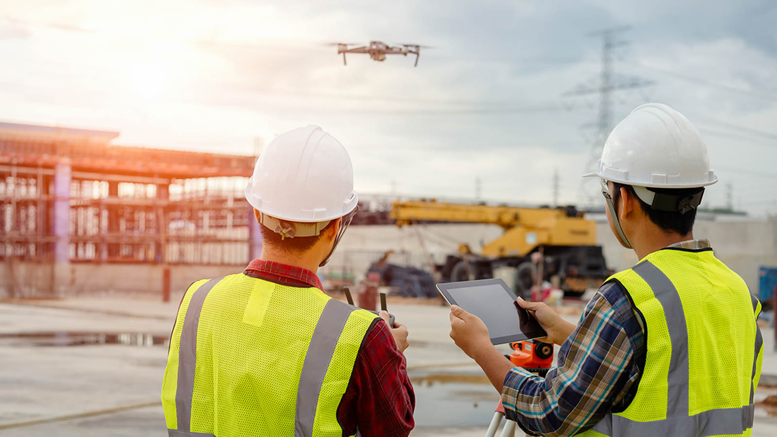 Drone operated by construction worker on building site,flying wi