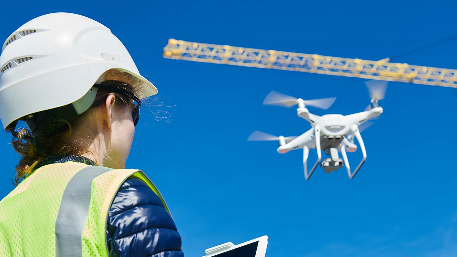 Drone inspection. Operator inspecting construction building site