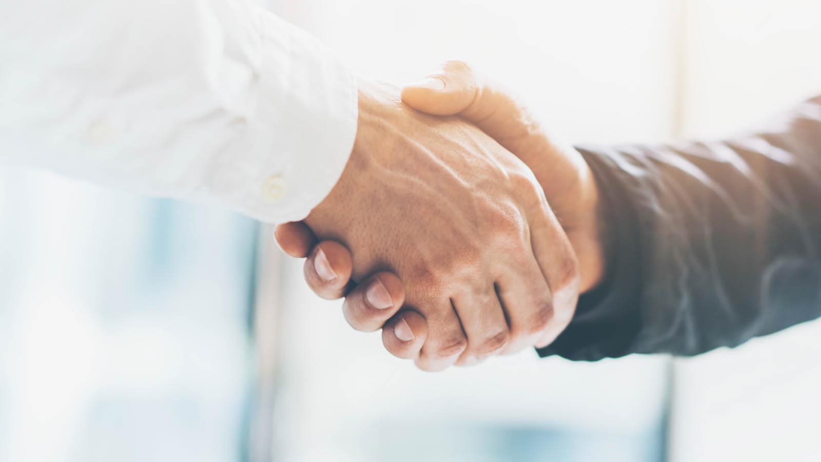 Business partnership meeting. Picture businessmans handshake. Su